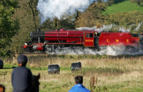 A steam train passing by Beaver Hall